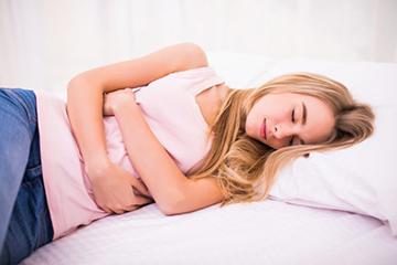 менструация и боль в животе